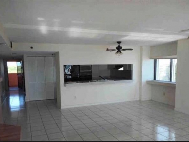 Living/Dining and Kitchen area before total remodel.