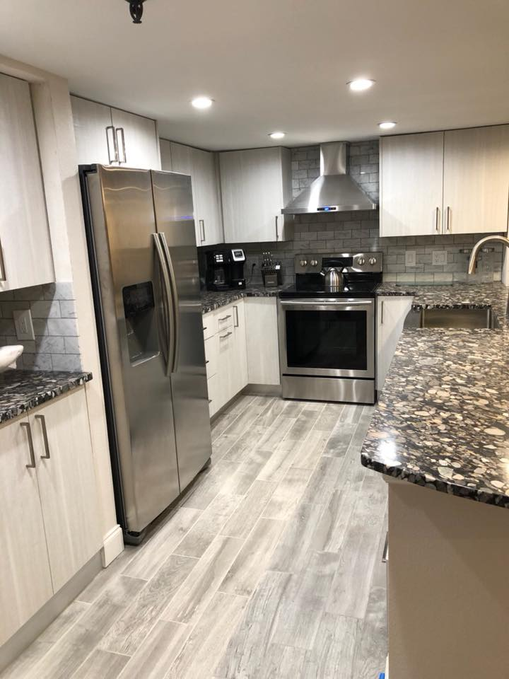 Totally remodeled kitchen with new all wood cabinets and granite counter tops.