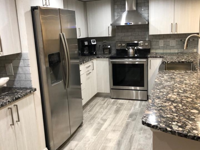 New all wood cabinets, granite counter tops, Carrara Marble backsplash, wall taken out to open up the kitchen to the living/dining area, and the ceiling was raised.